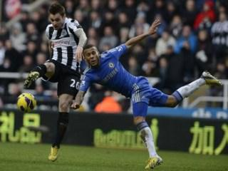 Chelsea's Bertrand challenges Newcastle United's Debuchy during their English Premier League soccer match in Newcastle